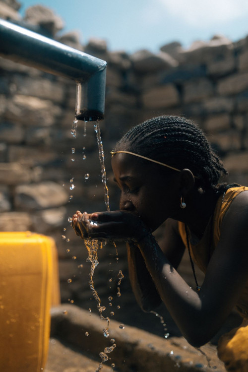 charity: water - girl drinking fresh water