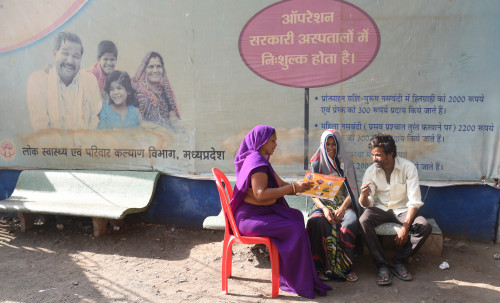 An accredited social health activist trained by staff from the Ipas Development Foundation counsels a couple on family planning methods in India.